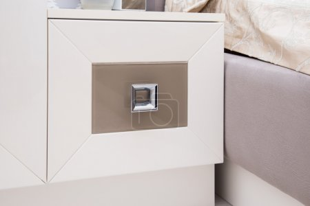 Contemporary bedside table in beige and brown colors