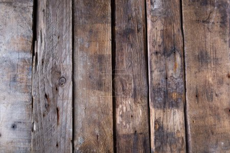 Photo for Wooden background from old raw boards in brown colors - Royalty Free Image