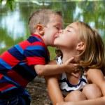 Постер, плакат: Little Brother Kisses Big Sisters Cheek