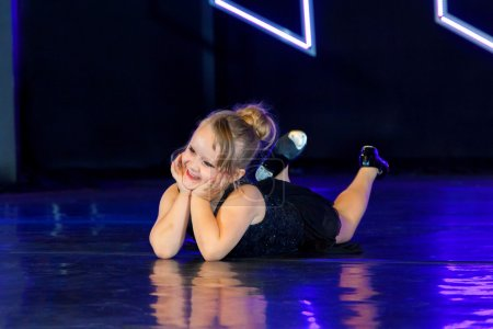 Adorable Tap Dancer Laying On Belly On Stage