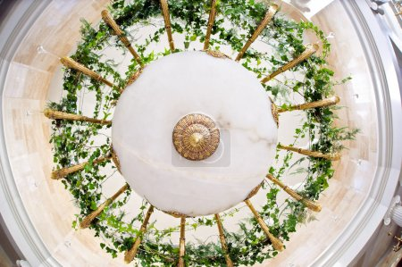 Wedding decorations on the chandelier of greens