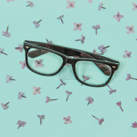 Lilac flowers and glasses