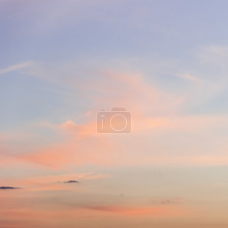 Photo for Orange clouds on pastel blue sky - Royalty Free Image