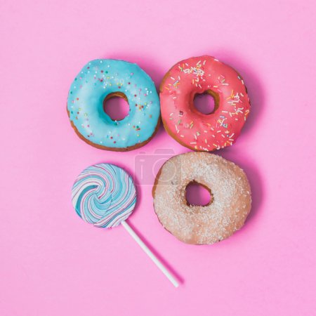 Photo for Three donuts and lollipop in creative fashion style - Royalty Free Image