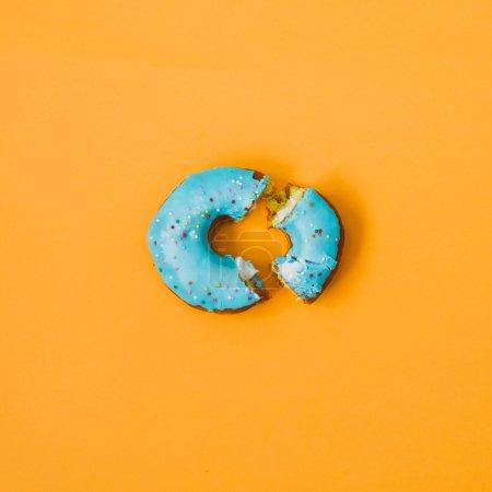 Photo for Broken donut on orange background. creative minimal set. - Royalty Free Image