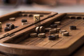 wooden Board with backgammon, pawns, dice, close up
