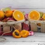 Постер, плакат: lots of fresh fruit cut on wooden background drink healthy food