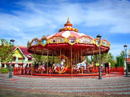 brightly colored carousel at the amusement Park