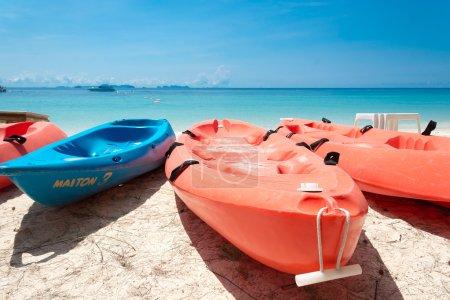 canoe on beach with blue sky