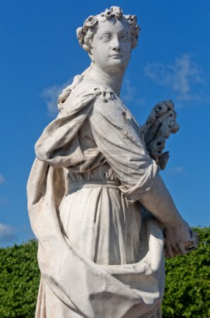 The Upper Garden. Fragment of a statue of Pomona in the blue sky.