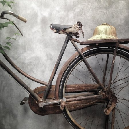 Vintage bicycle with old style hat at the back.