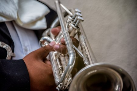 Selective focus shot of Mariachi trumpet player