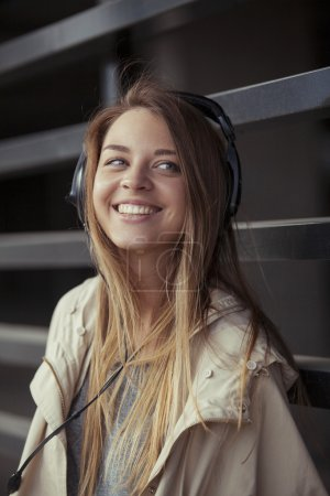 beautiful girl with headphones smiling