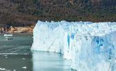 Tourist ship sailing near glacier Perito Moreno