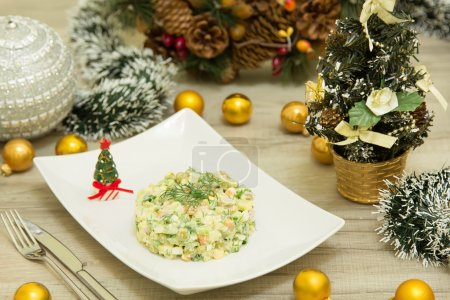 Traditional Russian christmas salad Olivier with sausage and fresh cucumbers