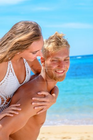Couple honeymooning at the the beach