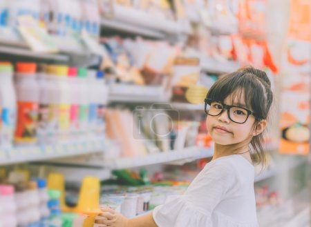 Girl at the shopping mall,Portrait of young girl at the shop standing near the shelves with sweets