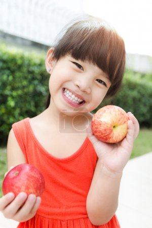 Photo for Funny food little girl with red Apple smiling happy. Healthy eating and vegetables concept photo - Royalty Free Image