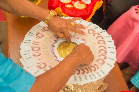 Bride price money in traditional wedding ceremony Thailand