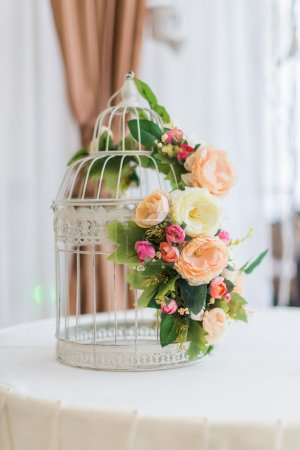 White cage with flowers as decoration on wedding