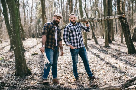 Photo for Two handsome bearded men in forest - Royalty Free Image