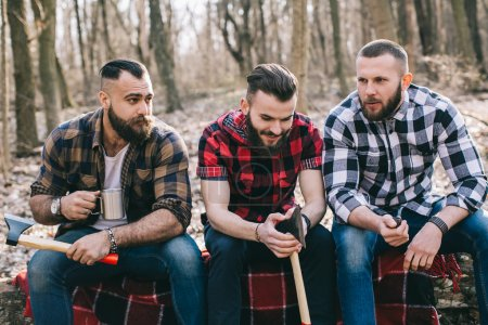 bearded men in a forest