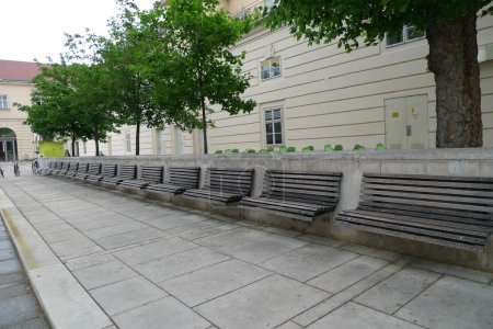 Mega bench on a street in Vienna. Alley in the long term