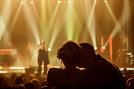 Love couple at concert of the famous Ukrainian singer Jamala