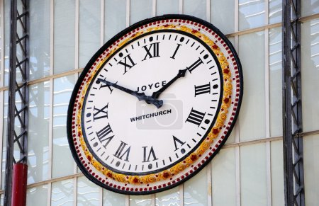 Wall clock by J B Joyce & Co in Lime Street Railway Station, Liverpool.