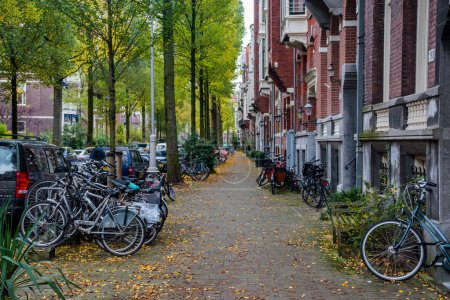 Parked bicycles and colorful architecture of Amsterdam