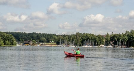 red Kayaks On Water In Good Weather.